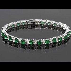 Jewelry - 18k White gold plated sim emerald tennis bracelet